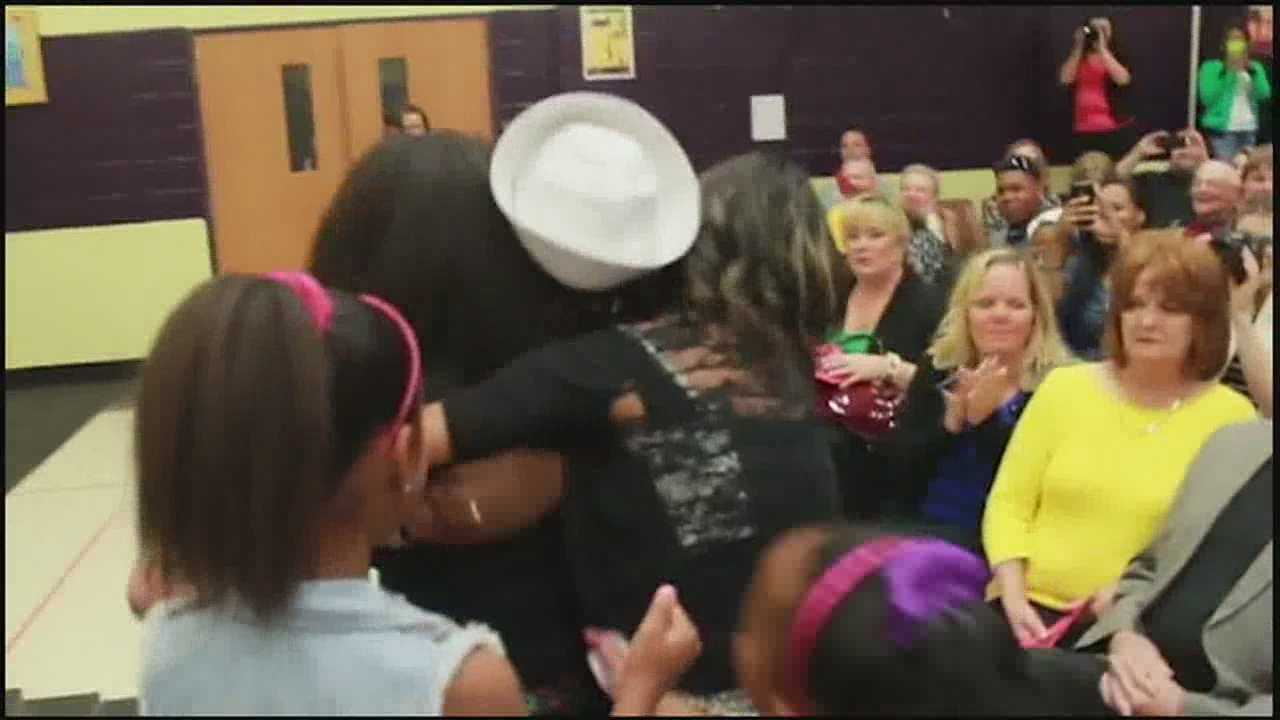 A man who's been serving in the Navy in Japan for the past 20 months surprised his daughter at an assembly at her elementary school in Blue Springs on Thursday.