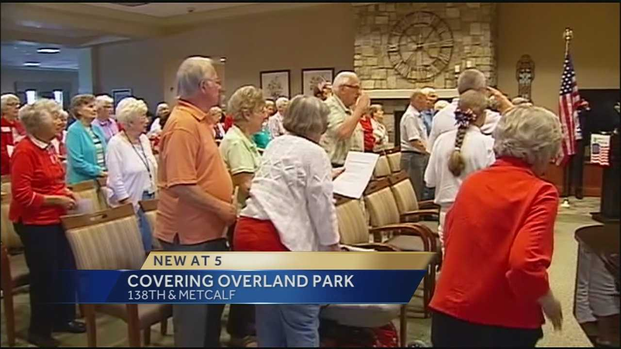 Hundreds of people gathered in Overland Park to help set a record for singing the national anthem.