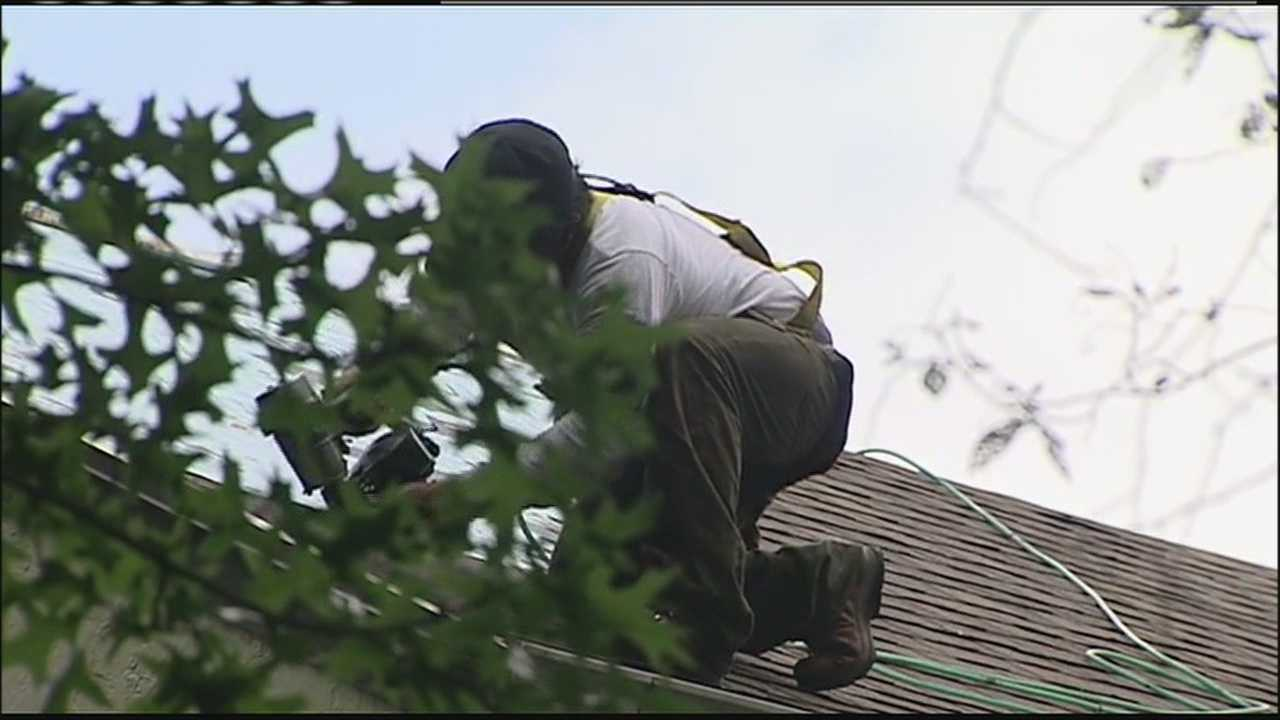 Roofers work to stay safe when temperatures soar