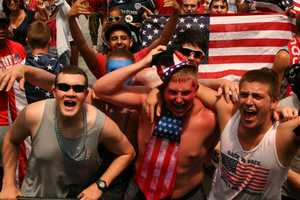 USA loses to Germany, but fans find out the U.S. Soccer squad has moved on because Portugal defeated Ghana 2-1.