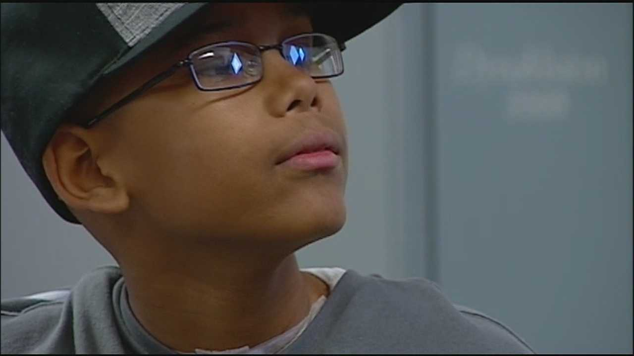 Boy paralyzed in gas station shooting makes progress