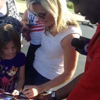 Meteorologist Erin Little makes a cameo appearance with her family and signs autographs with Bryan Busby.