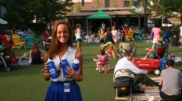 KMBC intern Emma Hogg helps pass out channel 9 water bottles to thirsty viewers.