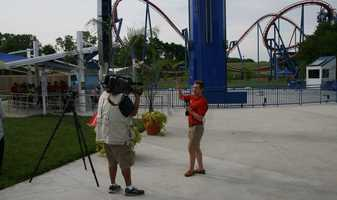 "KMBC's ""Hometown Weather"" tour traveled to Worlds of Fun Thursday.  Meteorologist Nick Bender and photojournalist Laz Abalos worked at the base of the SteelHawk ride."