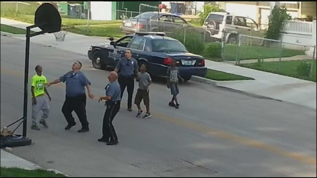 Three Kansas City police officers are getting attention for something that was caught on camera: Stopping in a neighborhood on Wednesday for an impromptu pickup game of hoops with some KC kids.