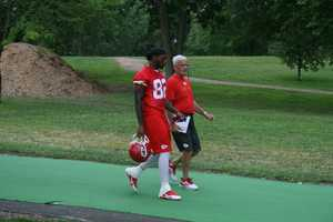 Photos from Chiefs training camp at Missouri Western State University in St. Joseph.  Dwyane Bowe walks down to the practice field.