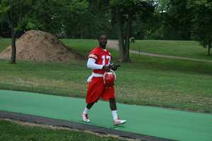 Photos from Chiefs training camp at Missouri Western State University in St. Joseph.  Donnie Avery walks down to the practice field.