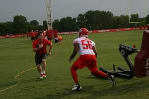 Photos from Chiefs training camp at Missouri Western State University in St. Joseph.  Linebacker Derrick Johnson hits the sled as defensive drills begin.