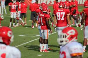 Photos from Chiefs training camp Thursday morning at Missouri Western State University. Chiefs rookie running back De'Anthony Thomas hears the play call in the huddle.
