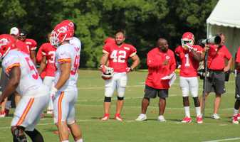Photos from Chiefs training camp Thursday morning at Missouri Western State University. Chiefs rookie running back De'Anthony Thomas stands on the sidelines.