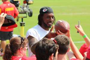 Photos from Chiefs training camp Thursday morning at Missouri Western State University. Players sign autographs for fans after practice.