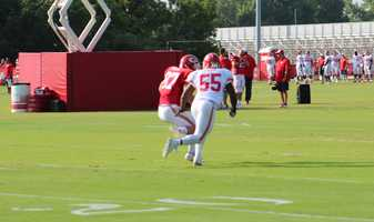 The Kansas City Chiefs practice a final time from training camp before their first preseason game versus the Cincinnati Bengals Thursday. Rookie Dee Ford drops into pass coverage during a drill with tight ends and running backs.