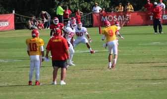 The Kansas City Chiefs practice a final time from training camp before their first preseason game versus the Cincinnati Bengals Thursday. Rookie Dee Ford simulates rushing the passer during a drill Monday.