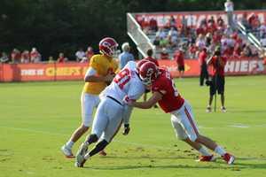 The Kansas City Chiefs practice a final time from training camp before their first preseason game versus the Cincinnati Bengals Thursday. Veteran defensive end/linebacker Tamba Hali pursues the quarterback.