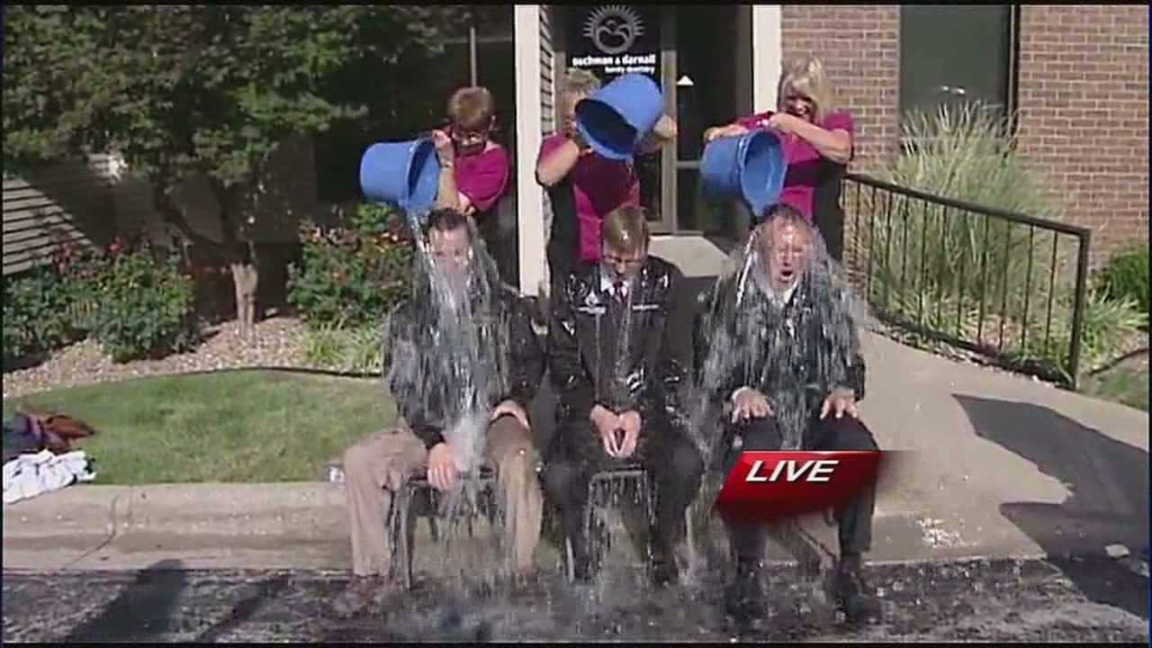 Three Independence dentists took part in the ice bucket challenge Thursday afternoon, including a father and son who have a special reason for doing so.