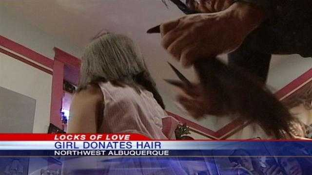 Girl gives hair to honor granddad's wish