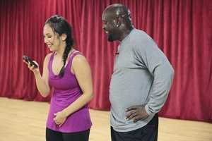 The NFL's all-time rushing leader Emmitt Smith and Cheryl Burke take a break from practice to laugh.