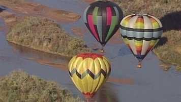 Winds delayed takeoff from Balloon Fiesta Park Monday morning, but numerous balloons took to the sky as planned.