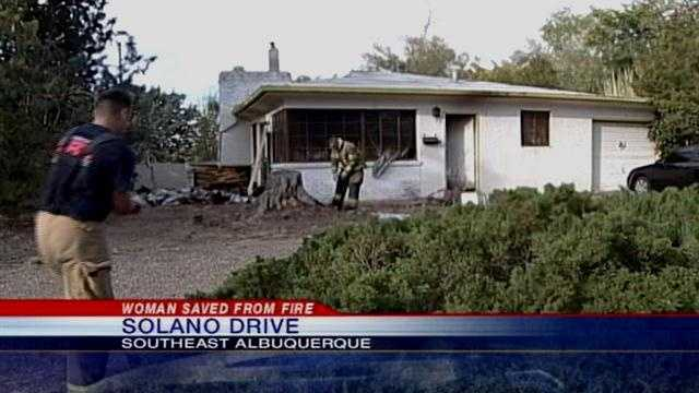 Firefighters rescued an 88-year-old woman from a burning home early Sunday morning.