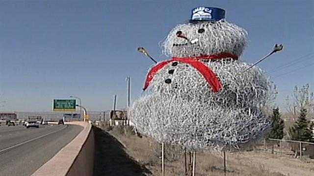 On Tuesday, crews from the flood control authority built a tumbleweed snowman. Workers said the drought made it hard to find tumbleweeds big enough for the task.