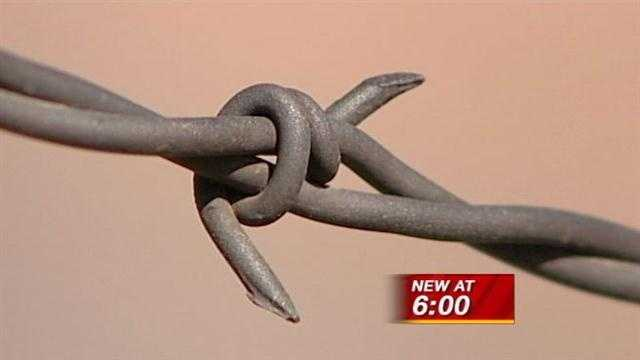 City council members say barbed wire fences are making the community look less safe.