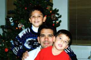 """""""Lots of good memories around the Christmas tree. Funny thing, during Christmas I always worked the video camera and Diane always took the still pictures. Years later we discovered that I wasn't in many of the videos (because shooting the home movies) and she wasn't in many of the still pictures (because she was always snapping the pictures on the still camera). We should have planned that part better, but Christmas was -- and is -- a very special time with the family as we remember the Reason for the season,"""" Joe said."""