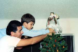 """The tradition of placing the angel at the top of the tree started with our oldest child Steven. We still have this angel on our current tree,"" Joe said."