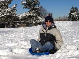 """I've always been a big kid at heart. And...when it comes to sledding, there's no exception! The perfect way to cap off a white Christmas is by speeding down a snow-covered hillside and getting a face full of fluffy snow,"" Byron said."