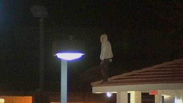 Suspect climbed onto motel roof