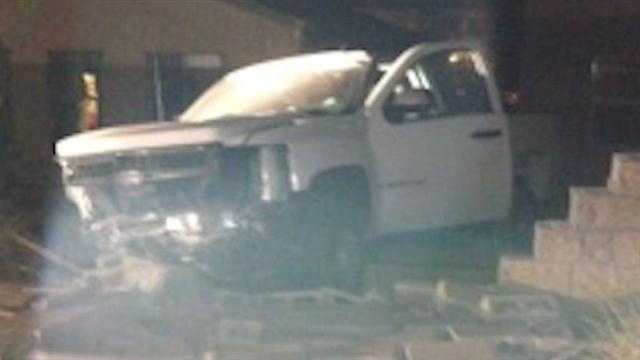 Homeowners angry over sharp curve after truck crashes into yard
