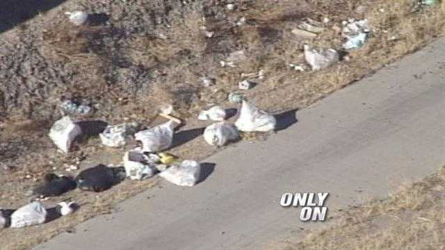 It's a smelly nasty problem.  People living in an apartment complex tossing their trash into a ditch leaving it to rot.