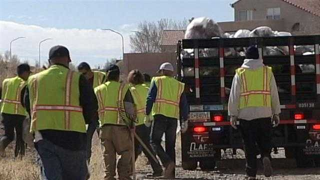 City picks up trash near apartment complex