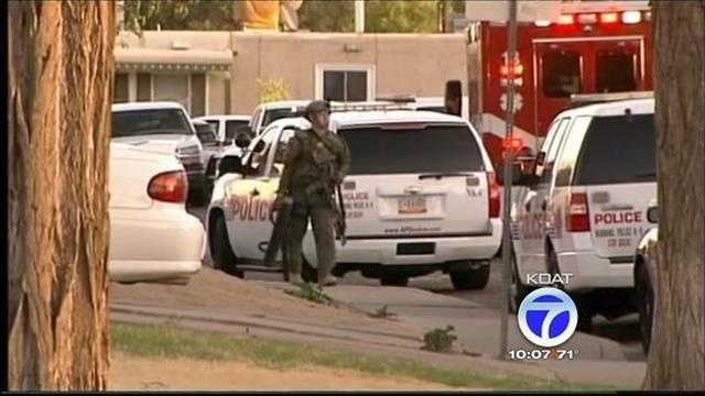 SWAT team members detonated three percussion grenades Monday night in order to coax a man out of a home in northeast Albuquerque.