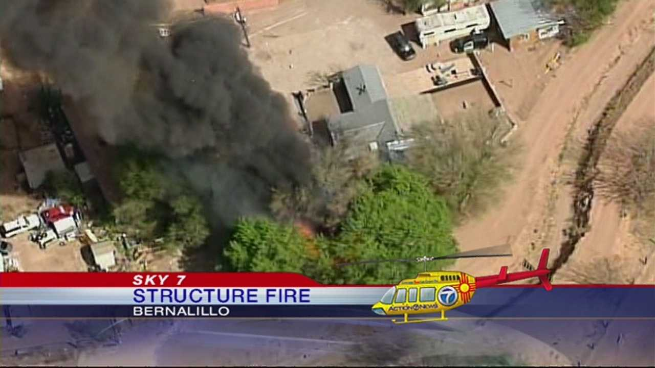 Fire burns structures in Bernalillo