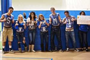Curtis, Sydnee, Jade, Kayleigh, Zach, Jeromy, and Megan show off their school spirit for the SSLC STORM Basketball teams at one of their home games. Way to cheer guys!!