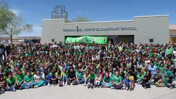 "One of our Colinas Hawks was recently in a horrific car accident, and is in the hosptial. We love her dearly, and the school decided to have a ""Wear Green for Luigi Day"". We asked everyone in the school to wear green in her honor. She loves the color green, and the character Luigi.We all gathered at the front of Colinas Del Norte in Rio Rancho, and took this picture to let her know that we missed her, and wanted her to get well soon. So you are seeing a photograph of 667 students, and 89 staff members.If we win this ""School Spirit"" Award, we are planning to donate the money to her Family, to pay for medical expenses."