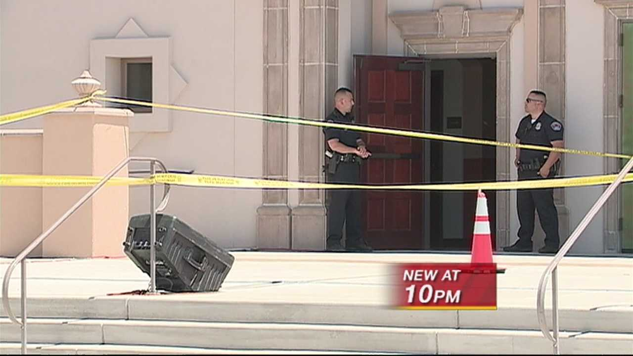 Albuquerque police are investigating the possibility that a stray bullet from a drive-by shooting hit a woman who was leaving Sunday Mass.