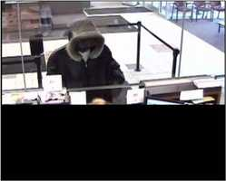 This unknown suspect robbed a bank in Milwaukee, Wisconsin on April 10, 2013. He wore a dark leather coat with a fur-lined hood, gold-rimmed aviator style sun glasses and blue jeans.