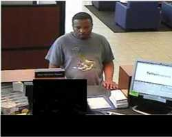 This unknown suspect robbed a bank in Milwaukee, Wisconsin on April 22, 2013. The subject had a gray short-sleeved tee shirt, blue jeans and black Army boots. Subject also had one to two days' worth of beard growth.