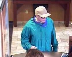 This unknown suspect robbed a bank in Denver, Colorado on April 18, 2013. The suspect entered the bank, approached the victim teller, made a verbal demand, received money and then fled.