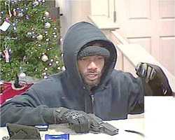This unknown suspect robbed a bank in Cincinnati, Ohio on Dec. 11, 2012. He wore a black hooded sweatshirt and a black mask. At one point during the alleged robberies, the suspect removed the mask. The suspect had a beard and goatee.