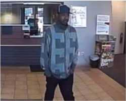 This unknown suspect robbed two banks in Milwaukee, Wisconsin in April 2013. He was wearing a two toned, square patterned cotton jacket, black baseball cap, dark jeans, black and white tennis shoes.