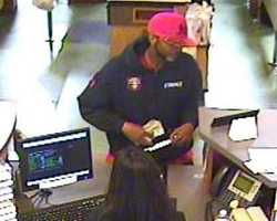 On April 5, 2013, an unknown subject robbed a bank in Sacramento, California. He had a full beard and wore a red A's ball cap, a black hooded sweatshirt, a red tee shirt, black pants and black and white athletic shoes.