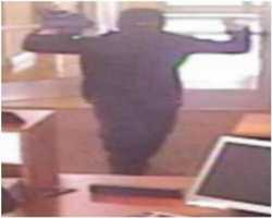 A Richfield, Minnesota bank was robbed Aug. 24, 2012 by this person. The suspect jumped over the teller counter and removed cash from the drawers of the teller stations.