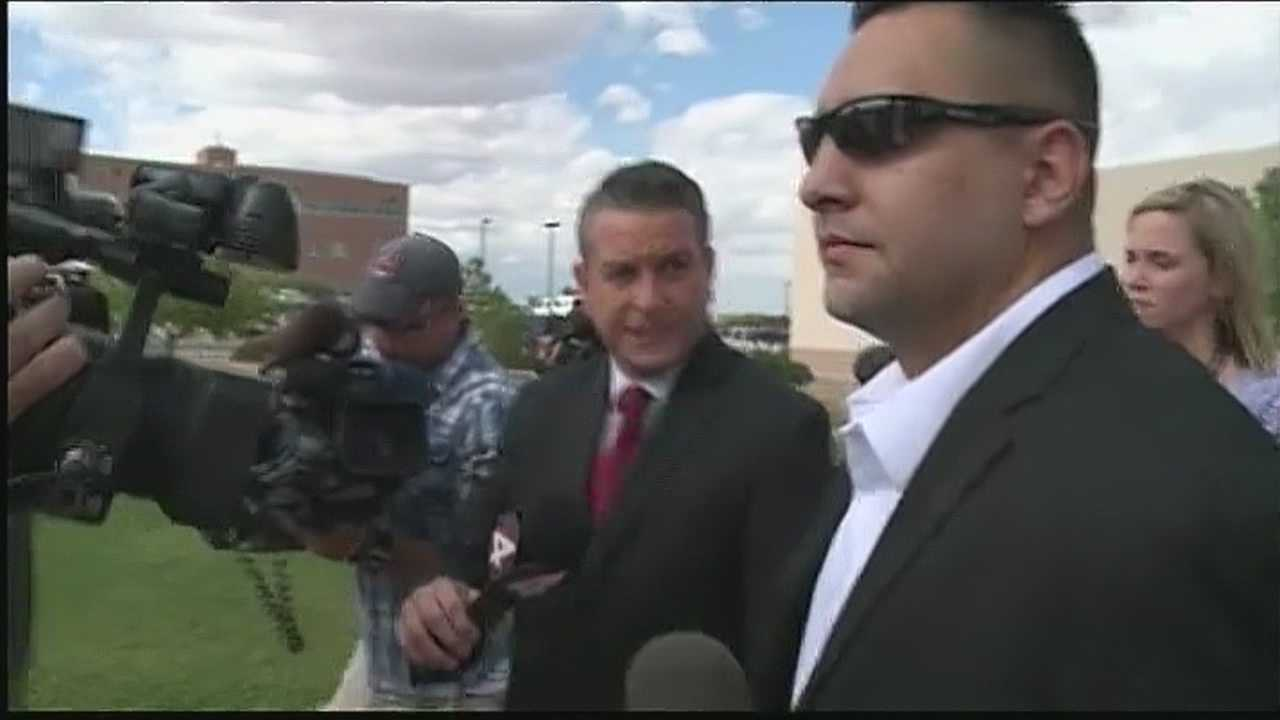 Former APD officer briskly exits courthouse