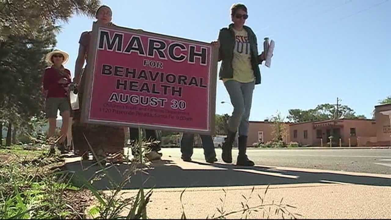 img-Dozens march demanding answers about behavioral health audit