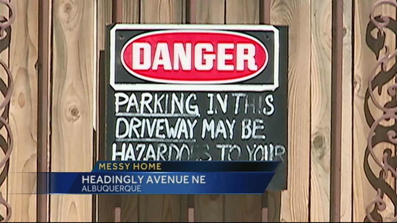 Neighbors have complained to the city about junked cars and auto parts laying around one homeowner's yard and unregistered cars parked along the street since 2009.