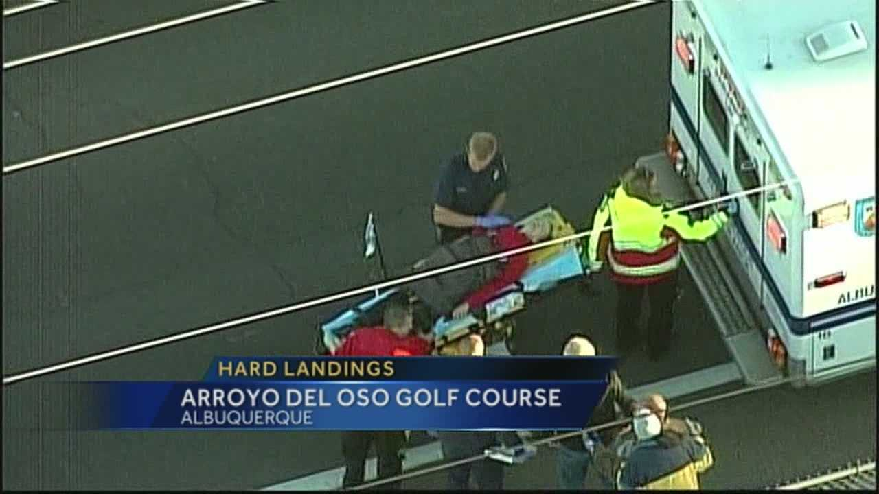 A woman suffered a broken leg when a balloon taking part in the first day of Albuquerque's annual balloon fiesta made a hard landing on a golf course.
