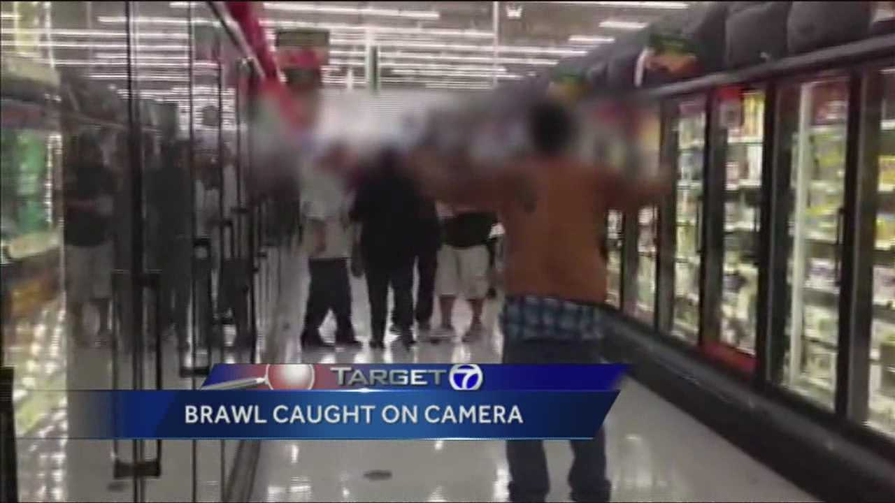 Caught on camera an explosive, blow-out brawl in the middle of a crowded Albuquerque superstore.