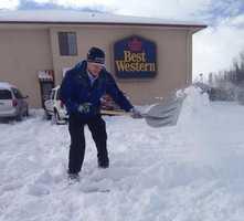 Mike Springer shovels some snow to set up a shot.